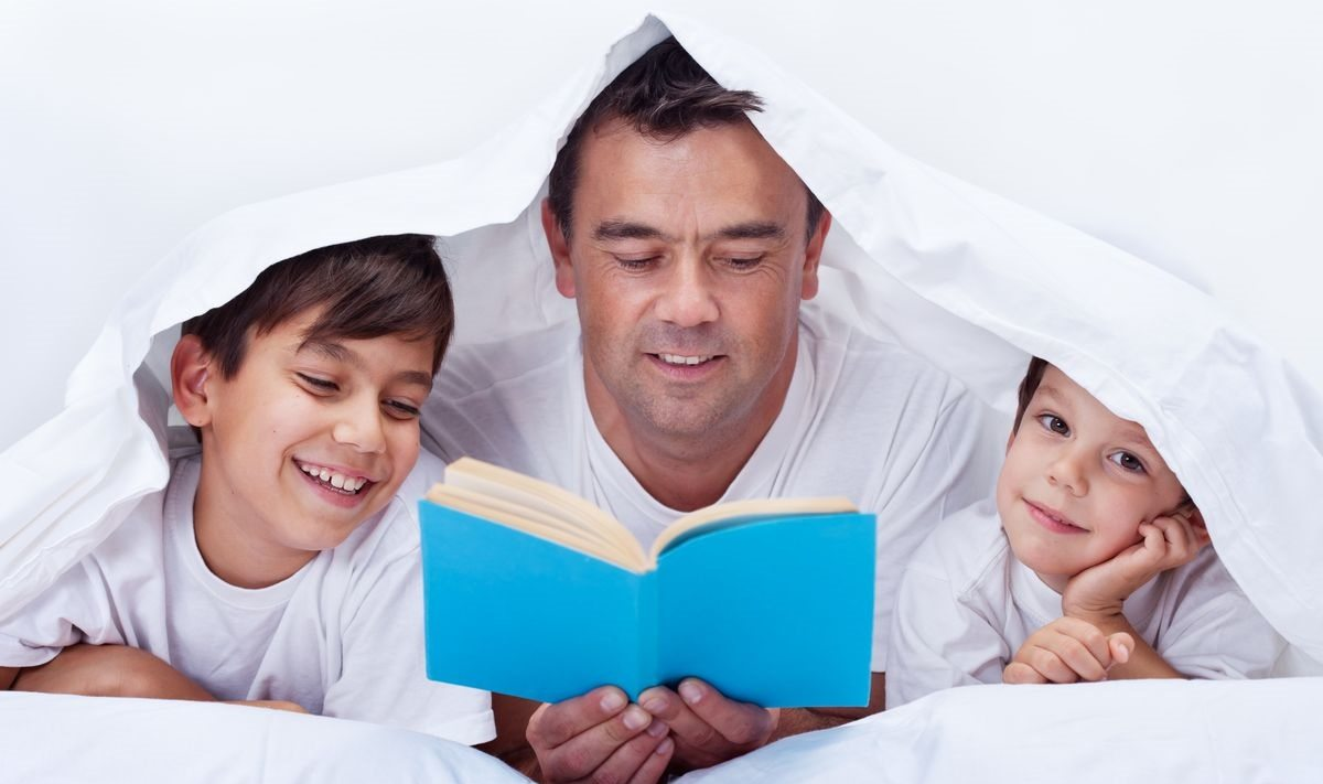 Dad Reading Books With Kids