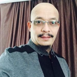Ustaz Kazim Elias Berkepala Botak