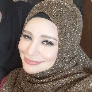Wajah Zila Bakarin Berhijab